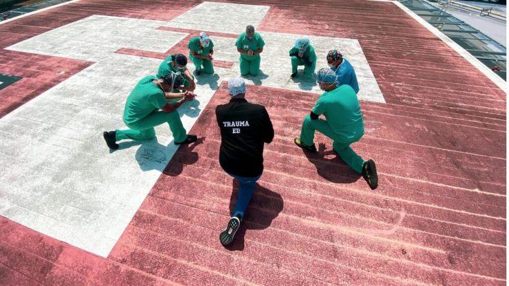 nurses-pray-Jackson-Health-System.jpg